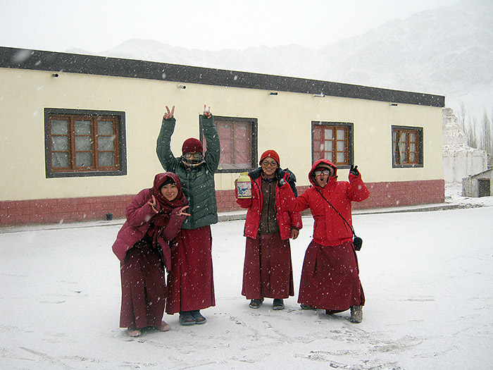 happy nuns in the winter in ladakh