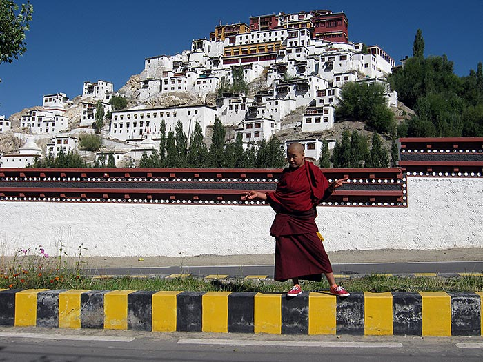 nun in front of Thikse monastery in Ladakh