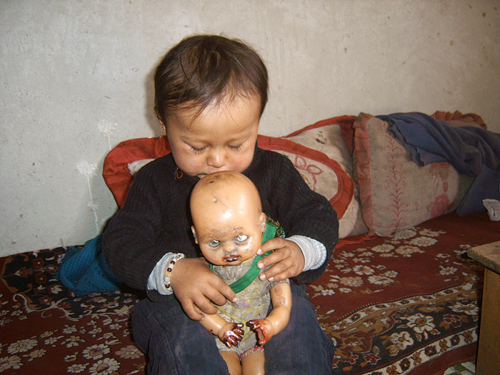 boy with doll in zanskar