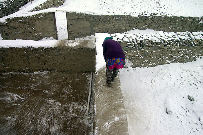 sweeping snow in Zanskar
