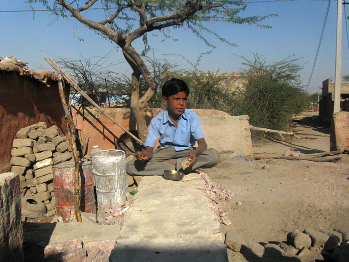 boy eating in Rajasthan
