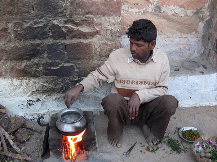 man cooking in rajasthan