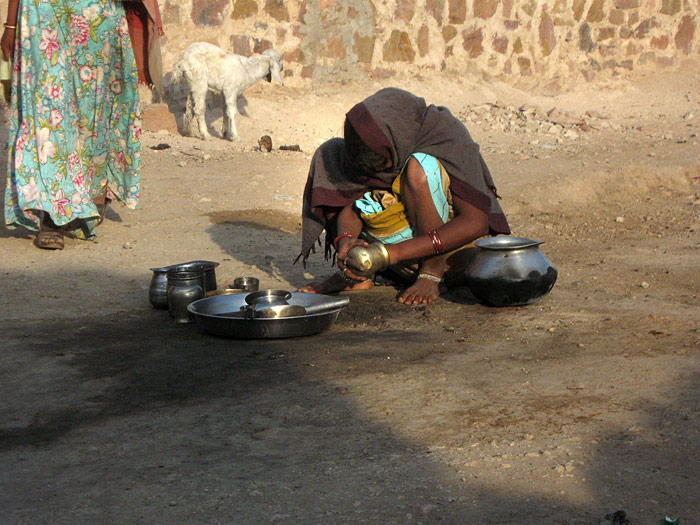 cleaning dishes in Rajasthan