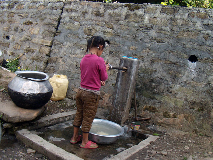 girl with water in Sikkim