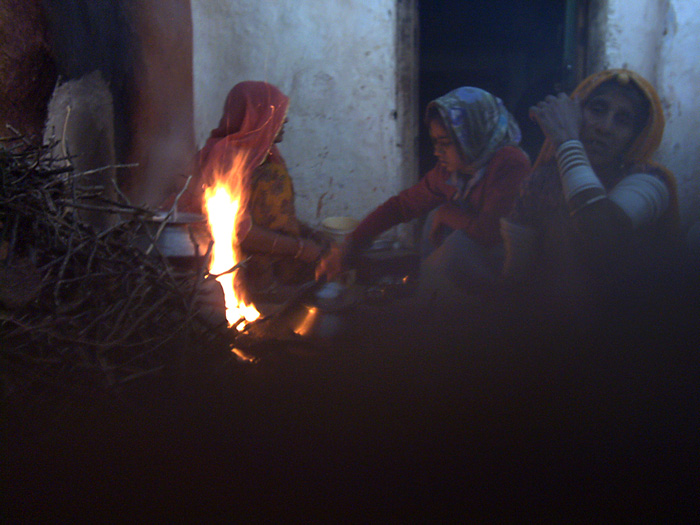 women sitting at the fire in Rajasthan