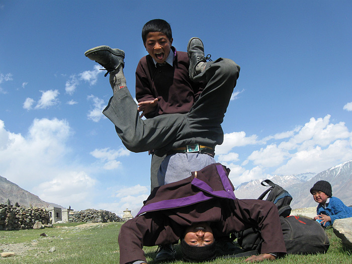 boy doing headstand in Zanskar