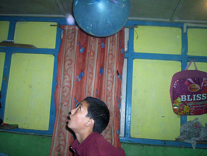 boy playing with balloon in Sikkim