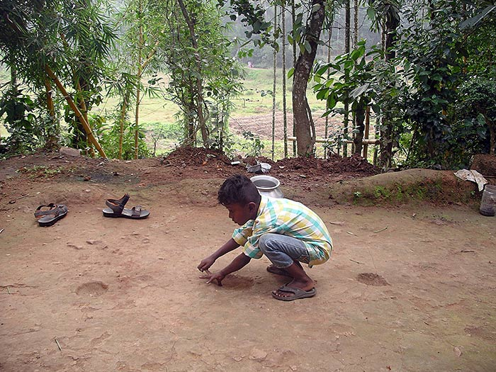 boy playing in Kerala