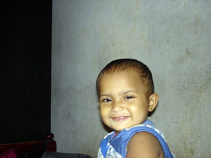 smiling toddler in Kerala