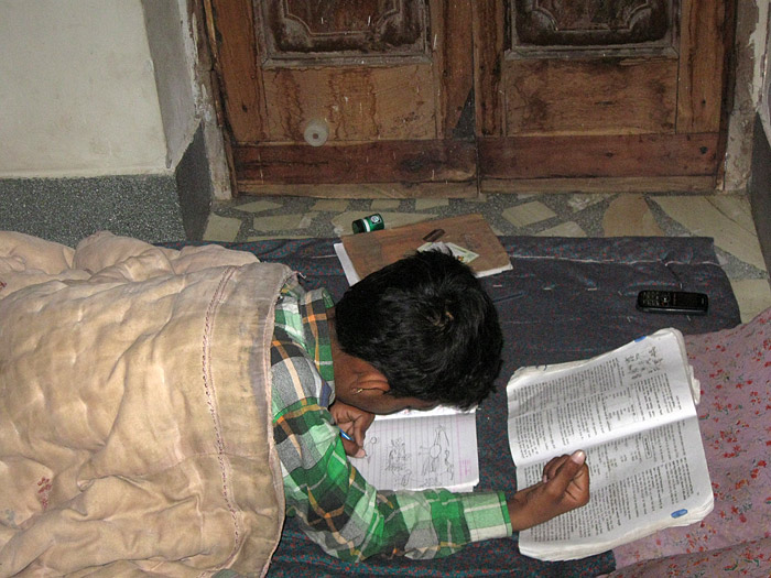 learning in a bed in Rajasthan