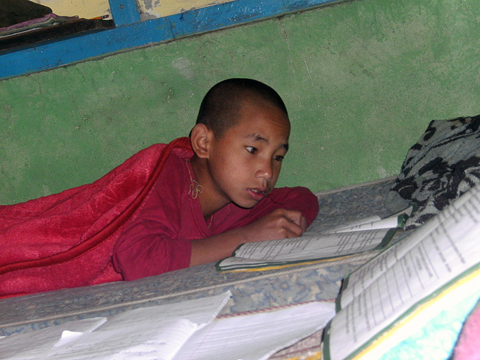 boy studying in bed in Sikkim