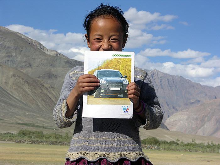girl with car-photo in Zanskar