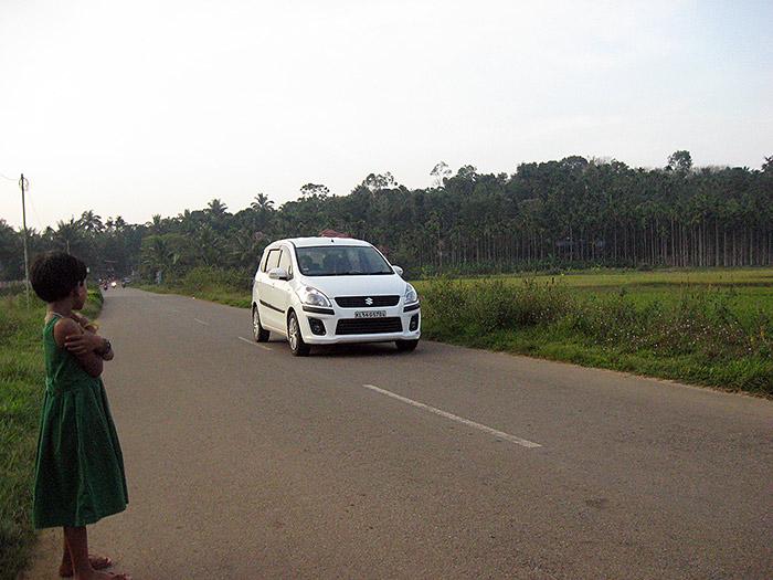 girl and car in Kerala