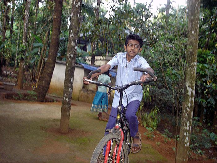 boy on bicycle in Kerala