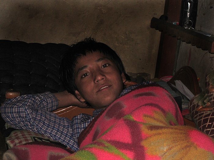 boy in bed in Zanskar