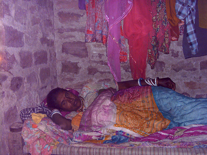 woman in bed in Rajasthan