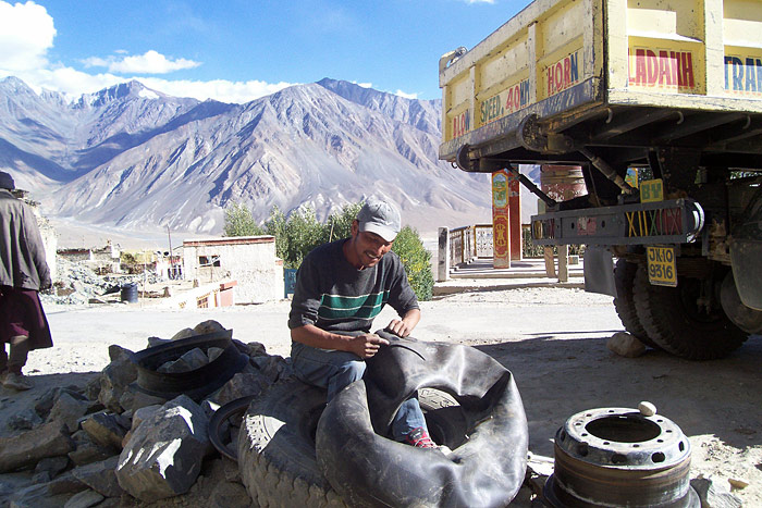 repairing a tyre in Zanskar